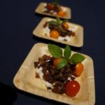 Chef Jessica Largey of the soon-to-open Simone's pickled tomato with burrata and olive crumbles