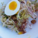 Chef Olivier Roussell of Luxe in the Sunset Boulevard Hotel's frisee salad with poached egg