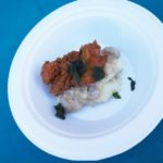 Chef Daniel Waked of The Arthur J's boneless fried chicken on a scoop of mashed potatoes