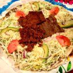 Tlayuda LA's namesake tlayudas topped with dried, grilled beef.
