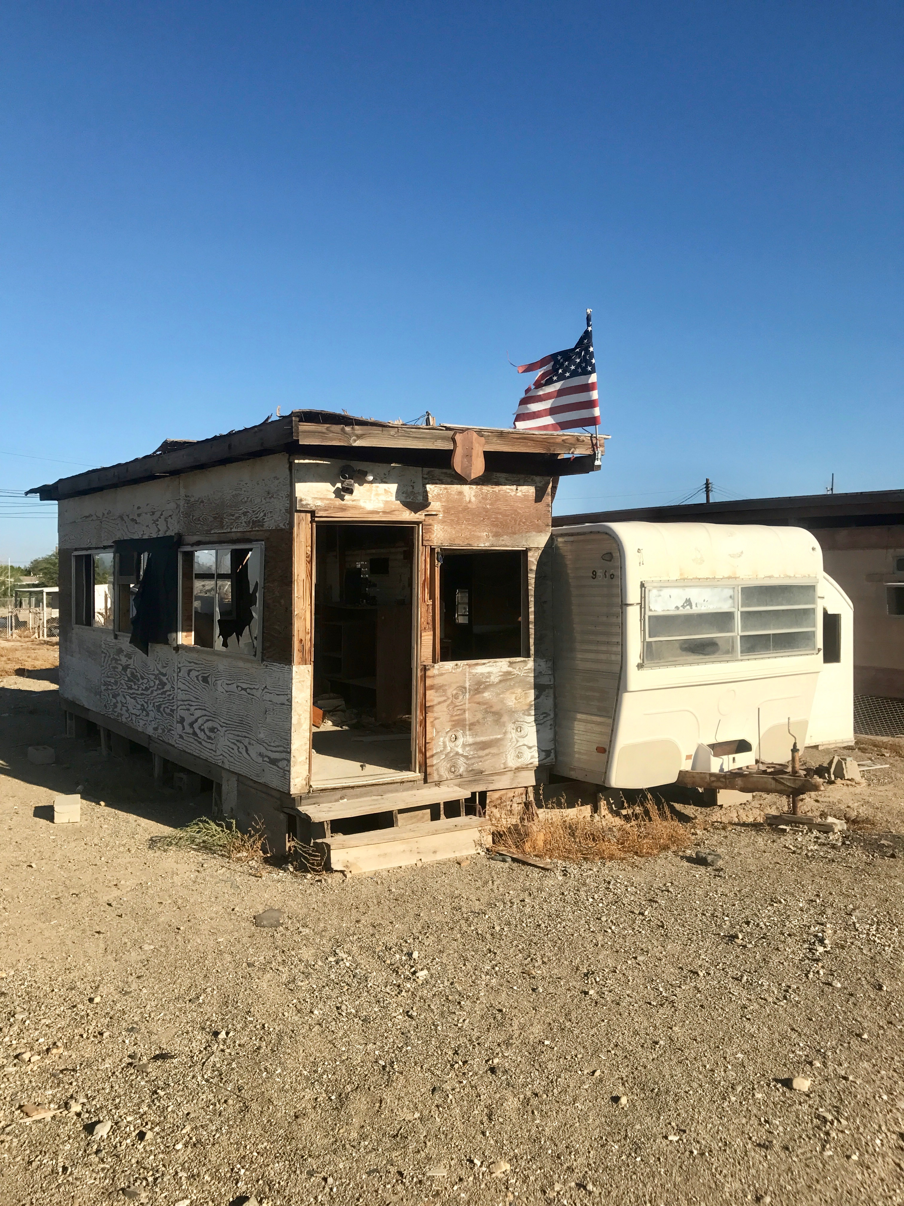 Abandoned Beach House And Shredded Flag At Bombay A Once Popular Resort Town On The Salton Seas Eastern Side Photo Nikki Kreuzer