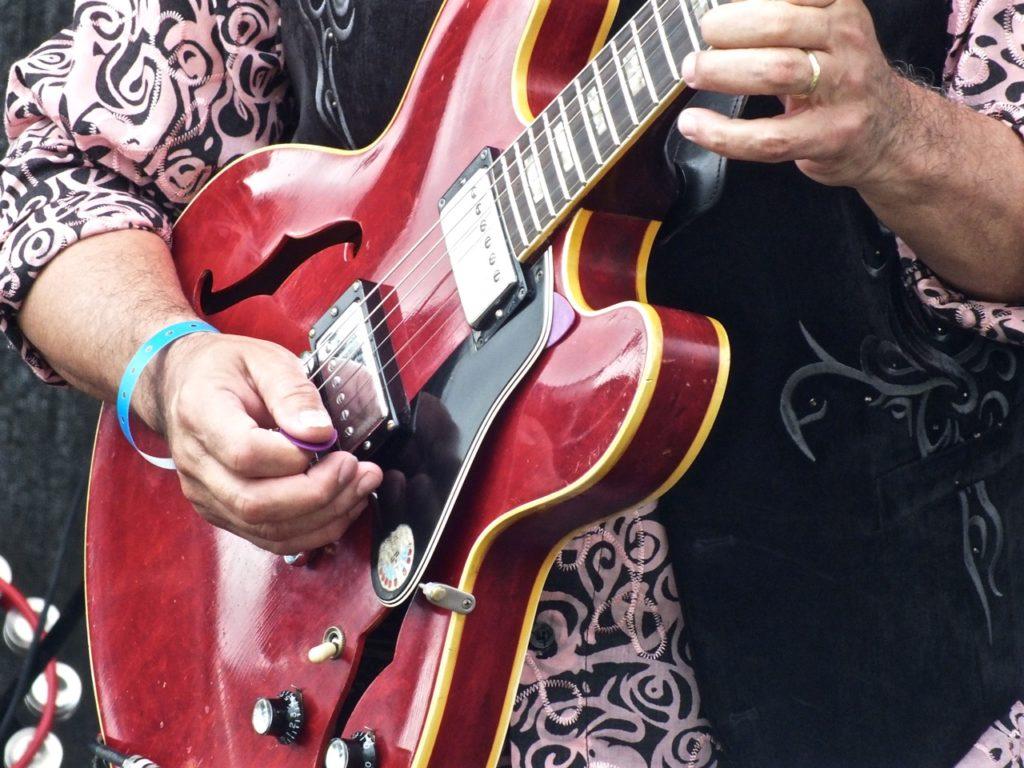 Joey Delgado, judge at Six String Showdown at New Blues Festival